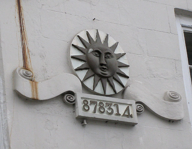 Sun Fire Office wall mount showing registration number. The company started operations in 1710 and within a century these fire schemes were common in Europe, Australia and America. Back in the 1990s, they used to run my occupational pension. Picture by Pauline Eccles, CC BY-SA 2.0, https://commons.wikimedia.org/w/index.php?curid=13921699